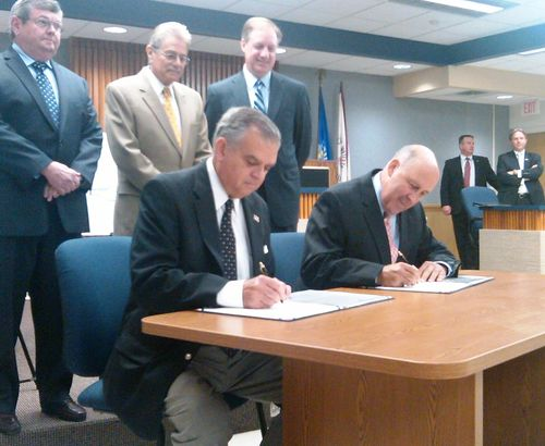 Signing with Gov Doyle