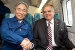 With JP Central Railway's Chairman Yoshiaki Kasai