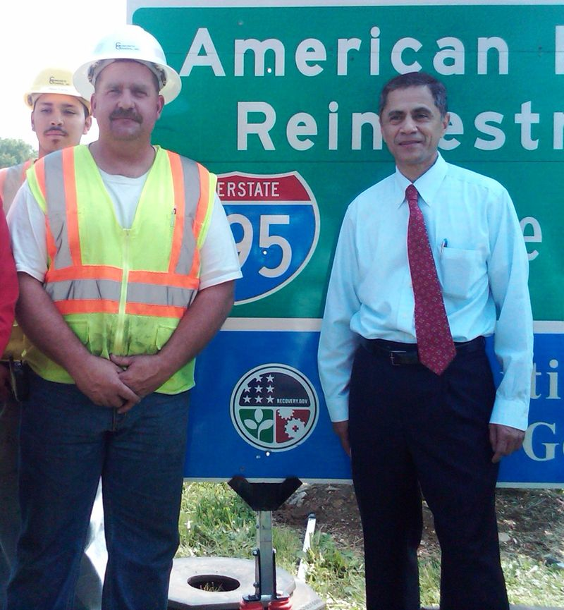Victor Mendez with employed road workers
