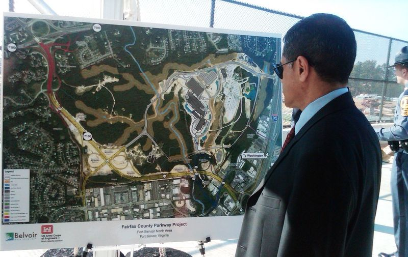Administrator Mendez looks at an aerial map of the project