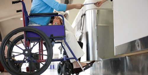 Picture of wheelchair user at airport