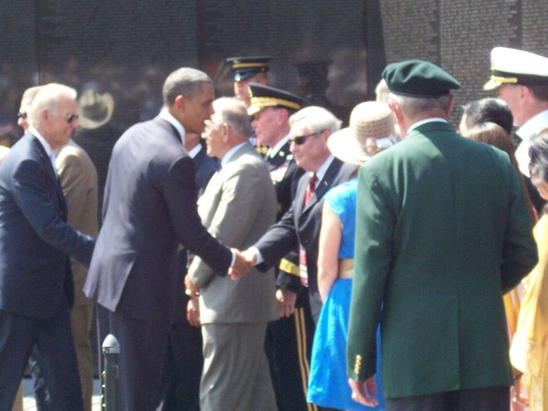 President Obama shakes hands with Bill Cahill
