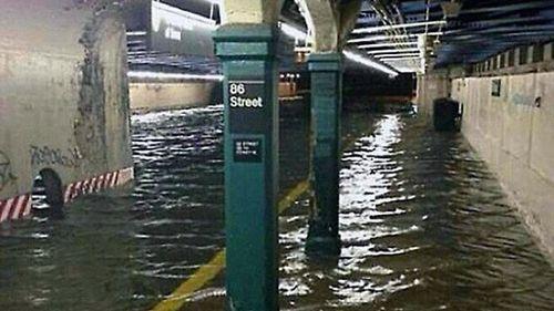 photo of 86th St subway station flooded courtesy wzohaib on Flickr