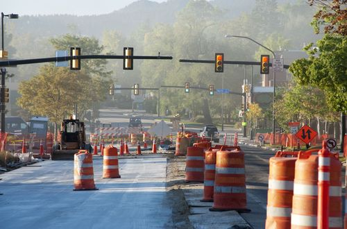 Photo of orange cones at a road construction project