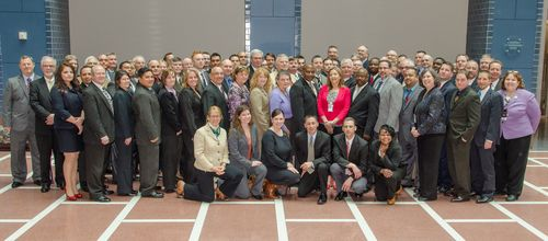 Photo of fifty investigators from around the country who gathered with FMCSA officials at DOT headquarters for the kick-off of their specialized training to utilize unique investigative techniques aimed at improving the safety of bus operators.