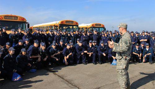 Capt Talliaferro briefs midshipmen before volunteer work