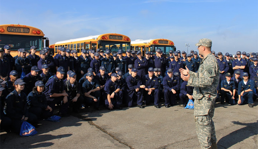 Capt Talliaferro briefs midshipmen before volunteer work