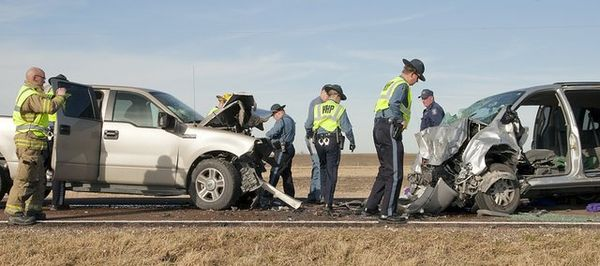 Photo of Kansas Highway Patrol Troopers, like guest contributor Casey Simoneau, on the scene of a crash