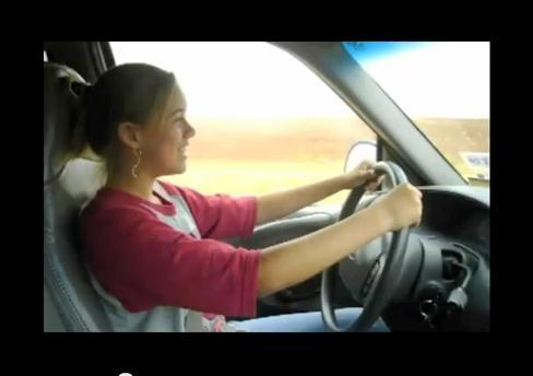 Alex behind the wheel of her truck