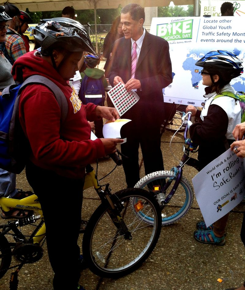 Administrator Mendez gives bike stickers at 2013 BTSD