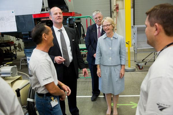 With workers on the Siemens floor