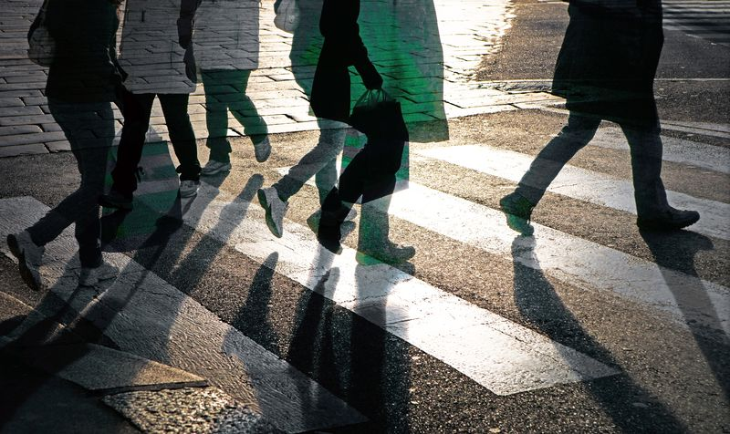 Pedestrian Silhouettes Crossing